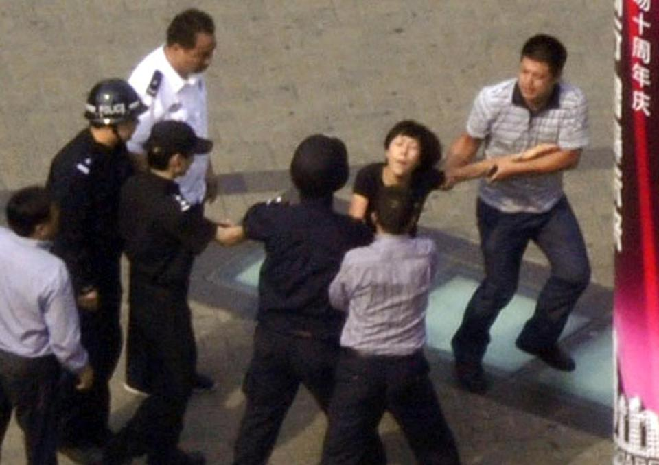 Officers arrested a protester at a march against a proposed expansion of a petrochemical factory in Ningbo, China.