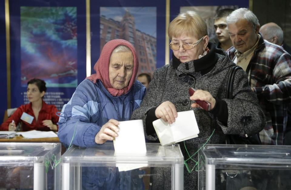 Ukrainian women cast their ballots at a polling station in Kiev during the parliamentary election.