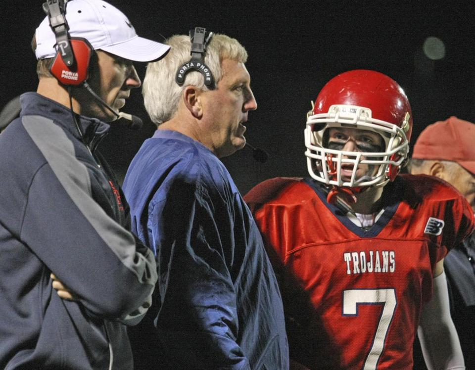 Bridgewater-Raynham quarterback Jordan Cohen confers with quarterback coach Mark Hartsell (left) and head coach Dan Buron during Friday's 27-7 win against Dartmouth.