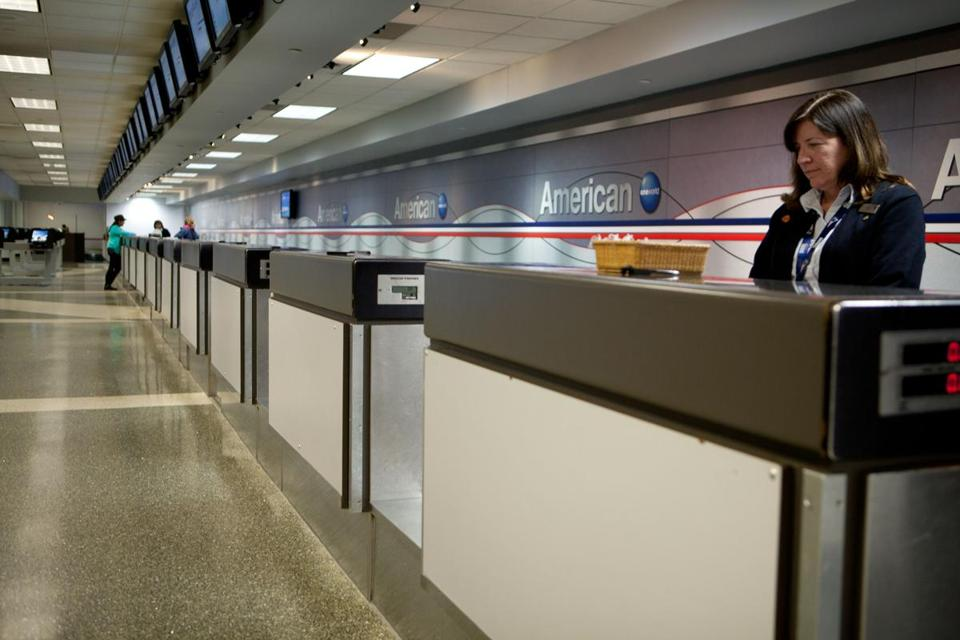 American Airlines agent Maura Kelly waited to help passengers with canceled flights in a nearly empty terminal B at Logan Airport.