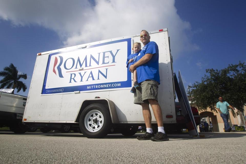 Keith Porro and his son, Austin, stood beside their campaign trailer outside an early voting site in Pembroke Pines, Fla, as they campaigned for Mitt Romney.