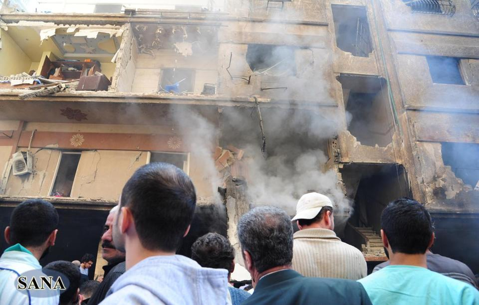 The state news agency showed footage of car-bomb damage in Jaramana, a suburb of Damascus. It said 11 people died.
