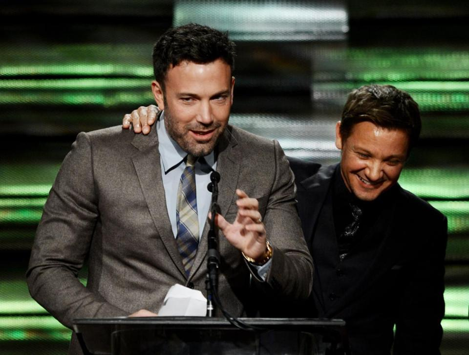 Ben Affleck (left) accepts the Casting Society of America's career award from Jeremy Renner.