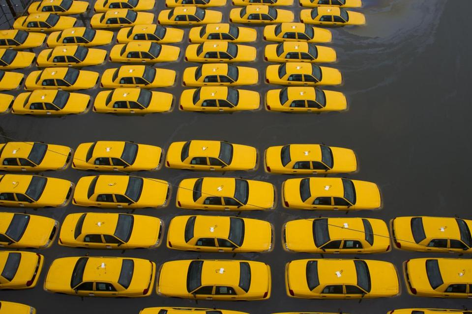 A parking lot full of yellow cabs was flooded in Hoboken, N.J., on Tuesday as a result of Hurricane Sandy.