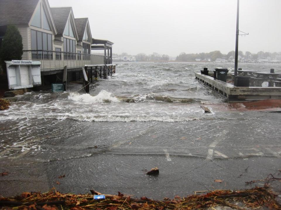 High tide swelled to 8½ feet around noon Monday in Newburyport, covering the Black Cow restaurant's lot.