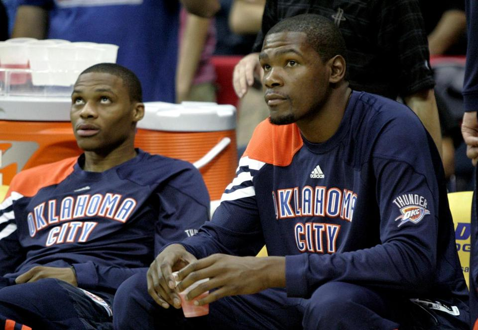Oklahoma City Thunder's Russell Westbrook, left, and Kevin Durant wait before the start of an NBA preseason basketball game, Wednesday, Oct. 10, 2012, in Hidalgo, Texas. (AP Photo/Delcia Lopez)