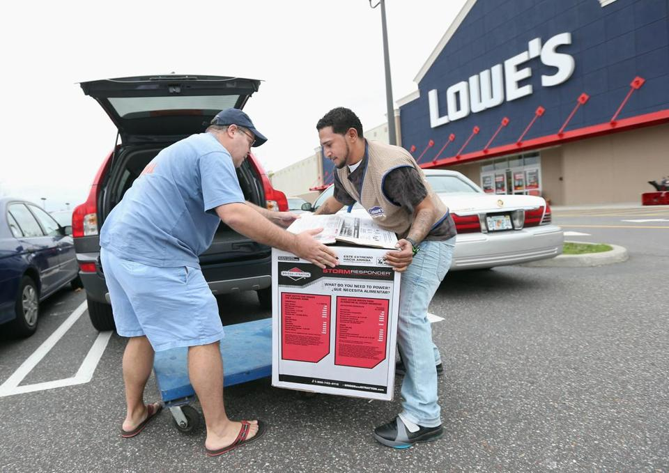 Joseph Klein of Sayville, N.Y., was assisted by Lowe's employee Ormani Rivera after he bought a generator as Hurricane Sandy approached.