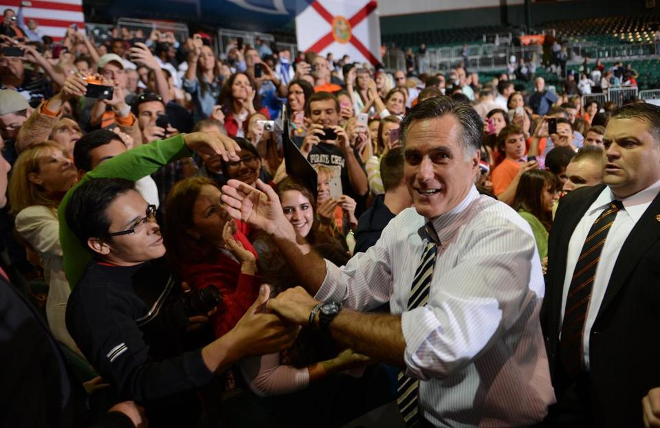 US Republican Presidential candidate Mitt Romney greets supporters during a rally at the University of Miami in Coral Gables, Florida, on October 31, 2012. AFP PHOTO/Emmanuel DUNANDEMMANUEL DUNAND/AFP/Getty Images