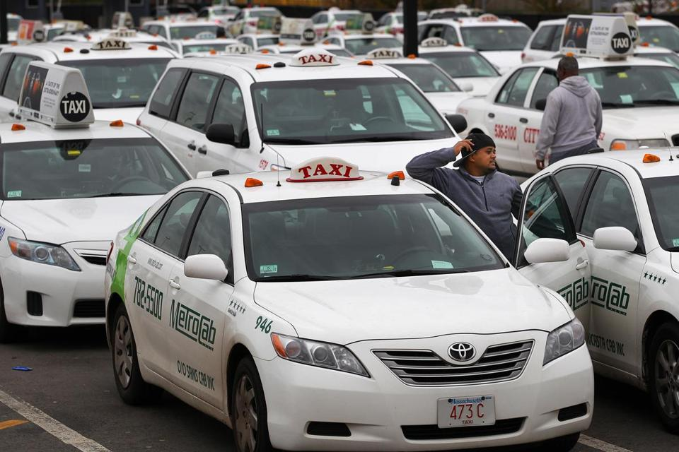 A the Logan Airport taxi pool, drivers waited in line on Wednesday.