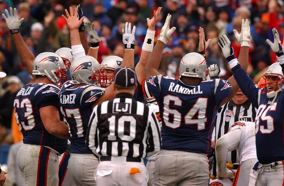 The Patriots offensive line celebrated after Antowain Smith's touchdown in the second quarter tied the game at 10-10.
