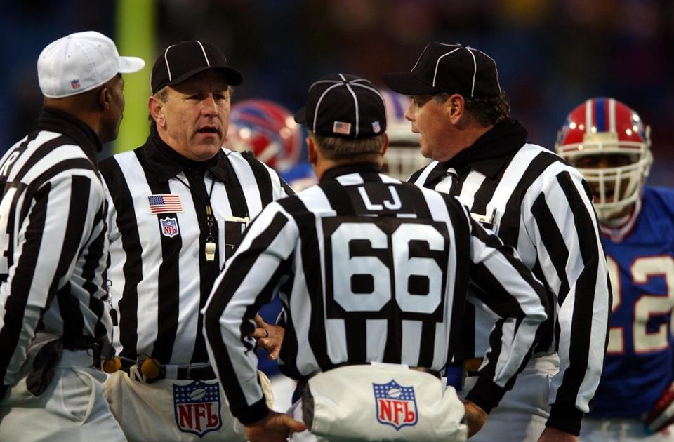 Officials huddled as they decided on a fumble call in overtime that would tilt the game in the Patriots' favor.