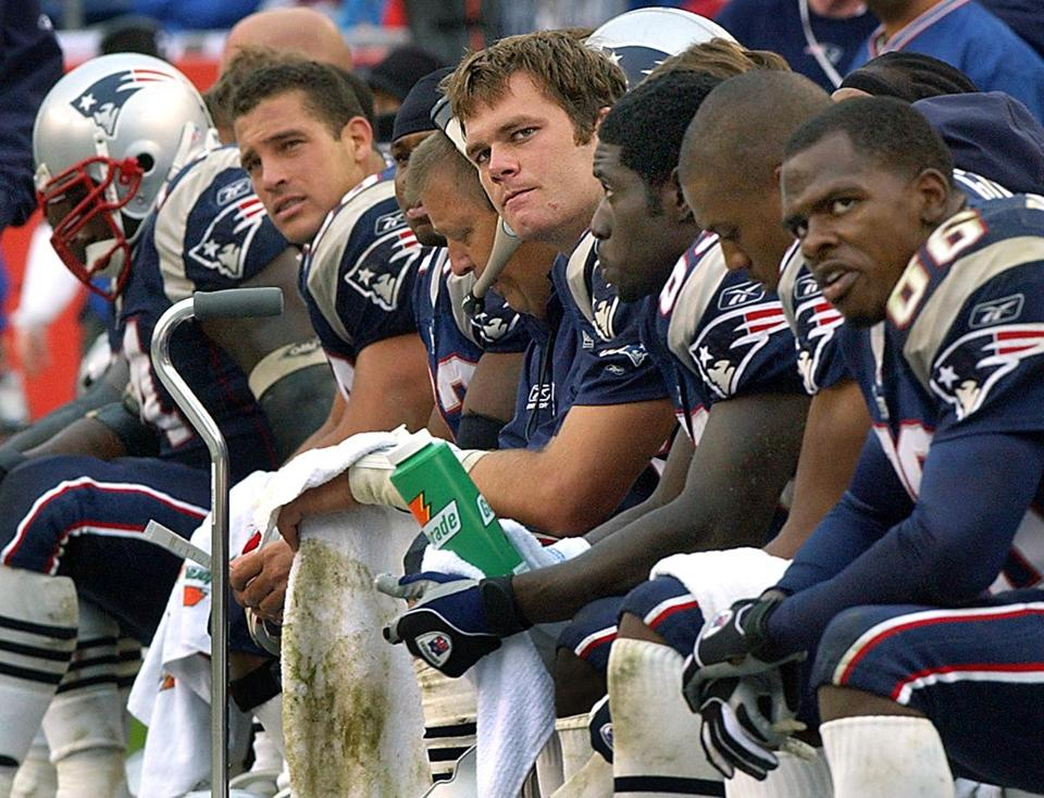 Tom Brady, center, and the Patriots had little to smile about late in the game. Brady threw three interceptions in the loss.