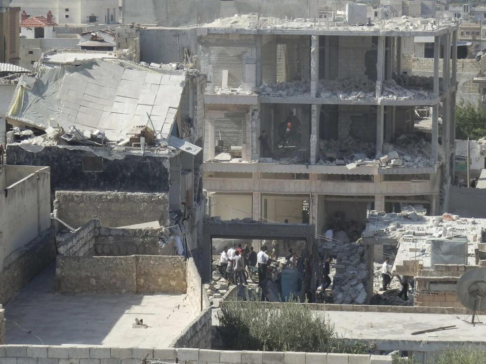 Residents of Binsh surveyed damage to buildings hit by a Syrian fighter jet on Saturday. Activists say that more than 36,000 people have been killed during the conflict.
