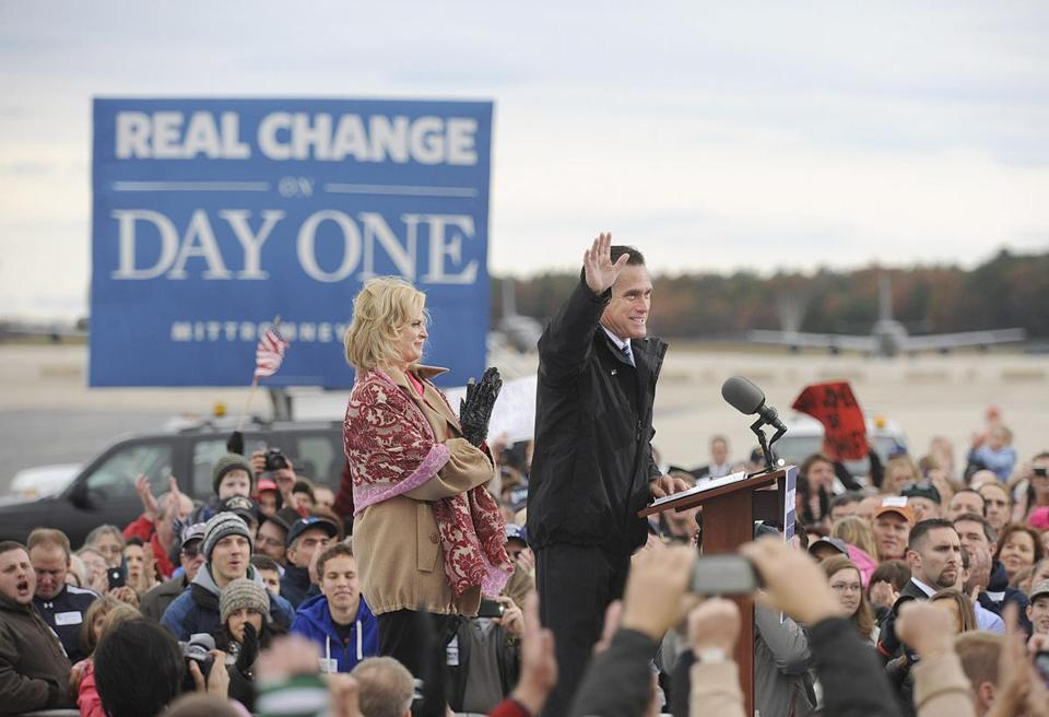 Mitt Romney, with his wife, Ann, revved up the crowd at a rally at Portsmouth International Airport on Saturday.