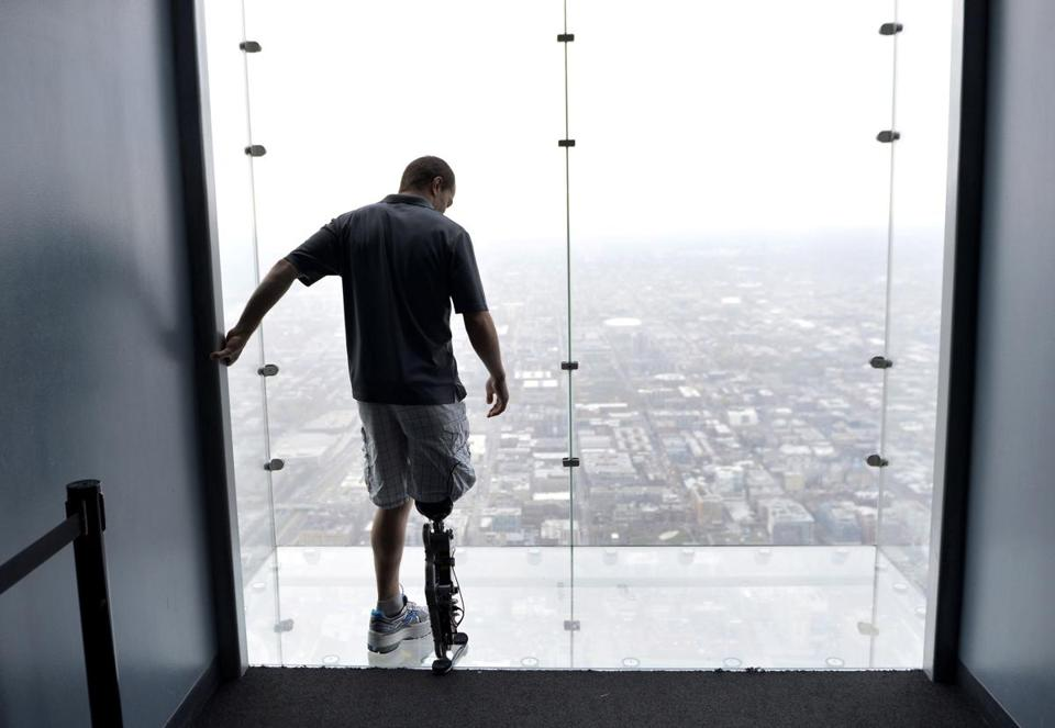 Zac Vawter, 31, fitted with an experimental bionic leg, checked out the view from the Willis Tower in Chicago on Thursday. The leg's movements are controlled by his brain.