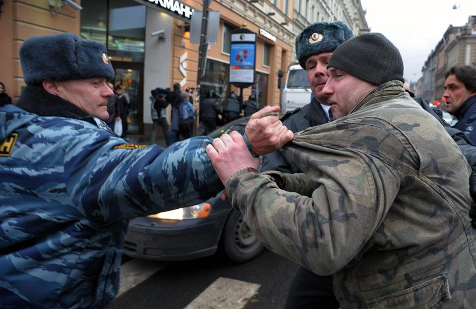Officers in St. Petersburg, Russia, confronted a protester in a rally that accused the government of favoring minorities.