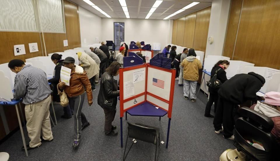 Early voters marked their ballots on Monday in Indianapolis.