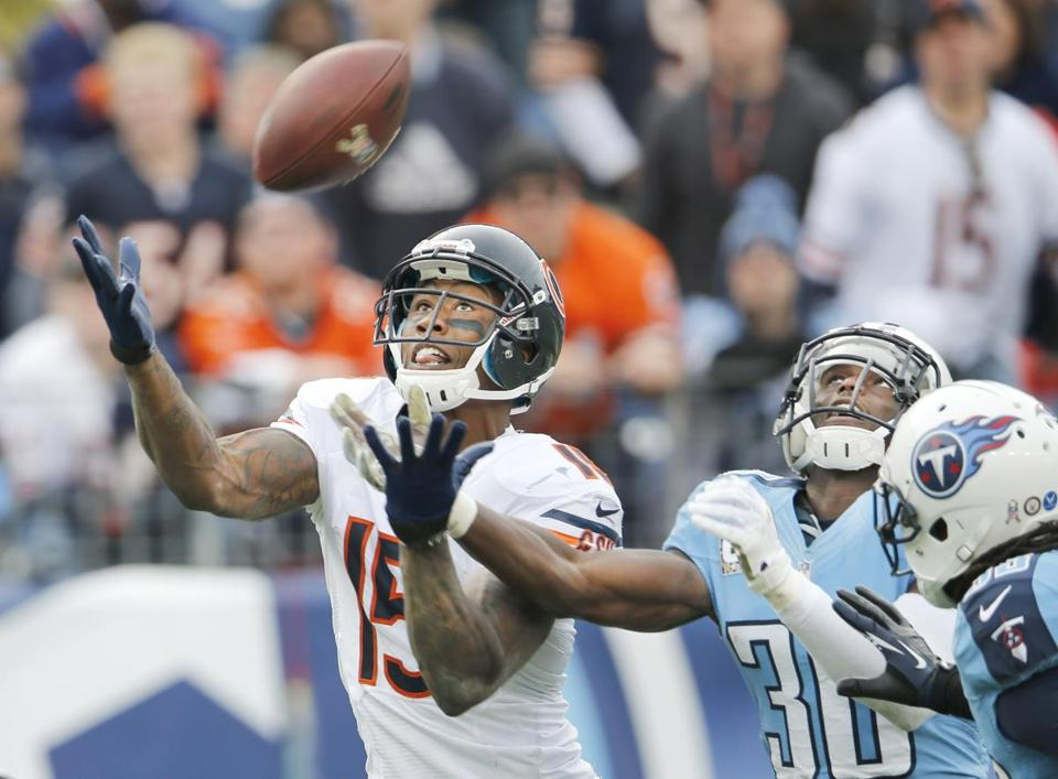 Brandon Marshall catches one of his three TDs for Chicago, which scored its most points since 1980.