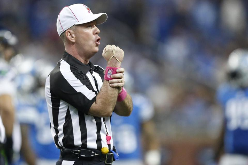 The NFL is wrestling with how best to put new technologies in the hands of officials like John Parry.
