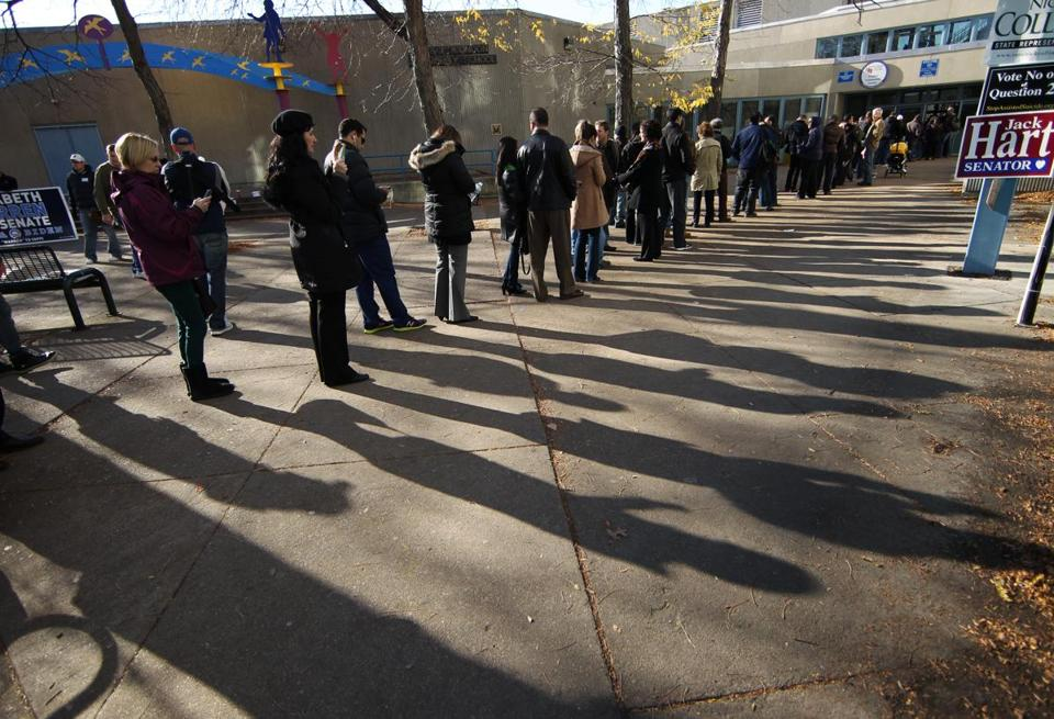 Midafternoon voters waited in line outside the Condon School in South Boston. Some waits stretched to three hours.