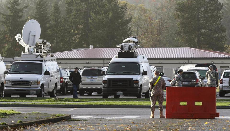 Television trucks were parked Monday near the military courtroom where a preliminary hearing began for Robert Bales.
