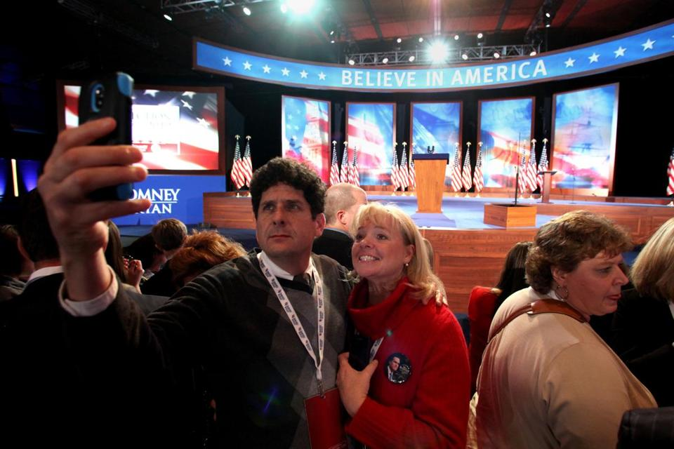 A couple at Mitt Romney's election night event Tuesday. Voting via smartphone would be risky, some experts say.
