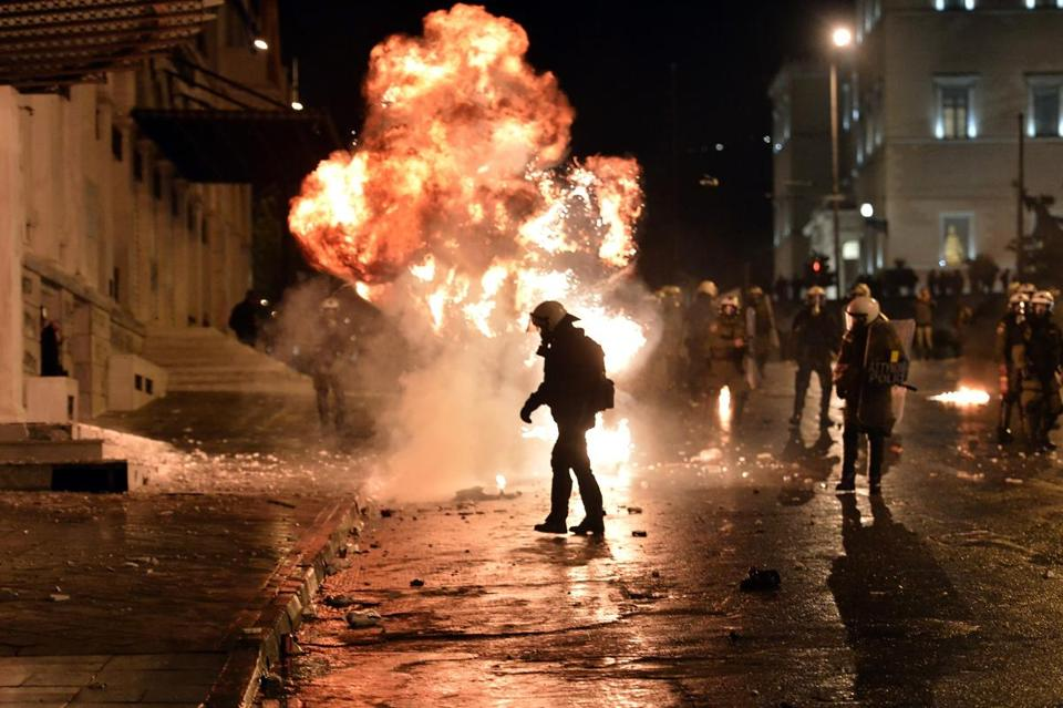 A gasoline bomb exploded near riot police during a demonstration against new austerity measures outside Parliament in Athens Wednesday.