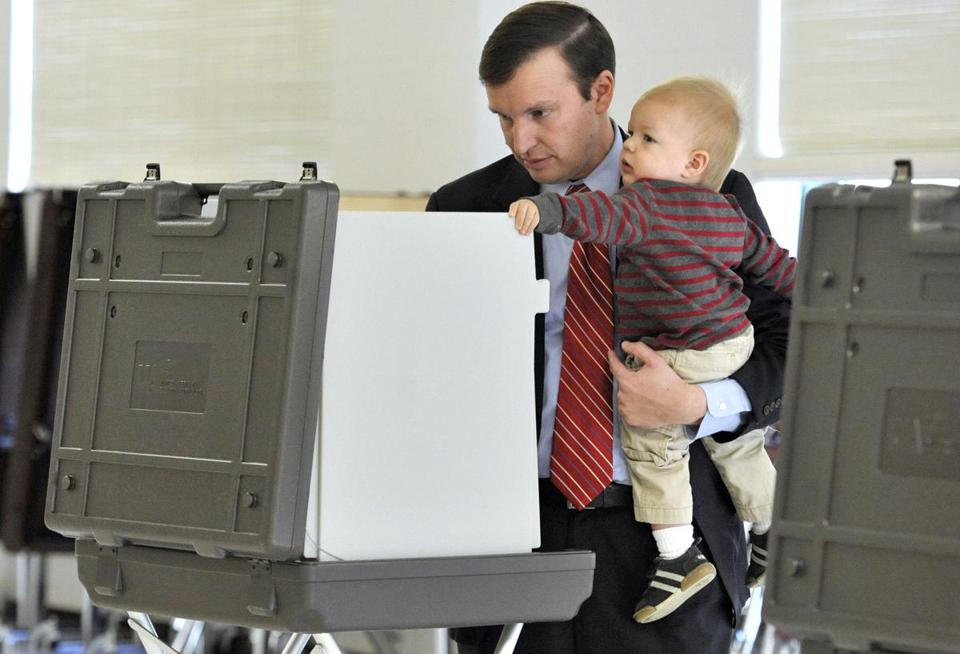 Democrat Chris Murphy, who bested Republican Linda McMahon in the US Senate race, voted with son Rider Tuesday.