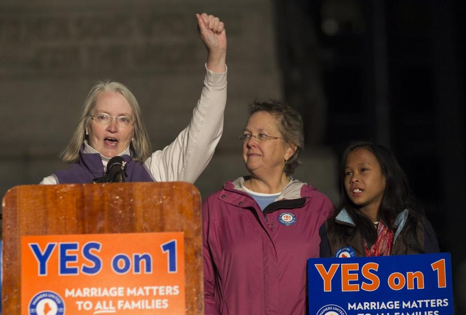 Sarah Dowling (left), her partner Linda Wolfe, and their daughter attended a rally for gay marriage in Portland, Maine.