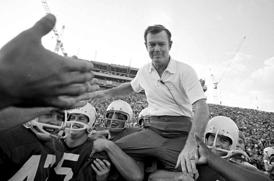 Texas coach Darrell Royal was carried off the field after his team beat Arkansas in 1970.