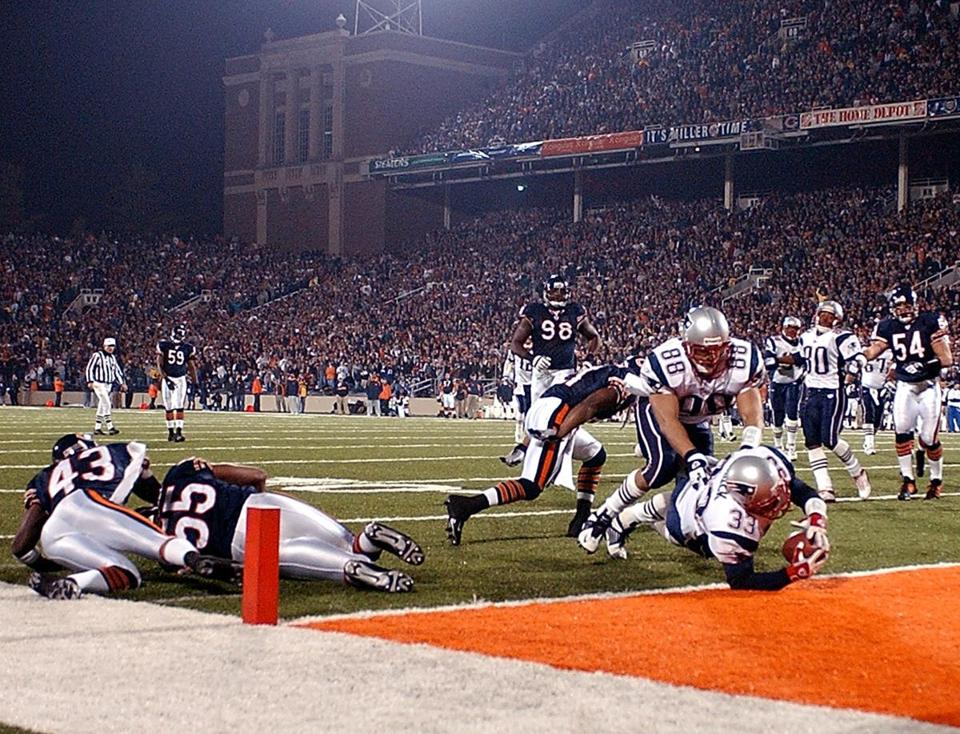 Kevin Faulk dived into the end zone with help from Christian Fauria for this third quarter touchdown.