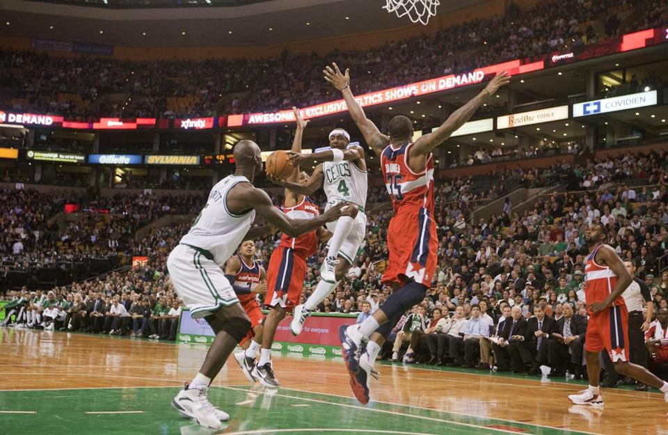 Jason Terry (4) dishes off to Kevin Garnett for two points against Washington at the TD Garden.