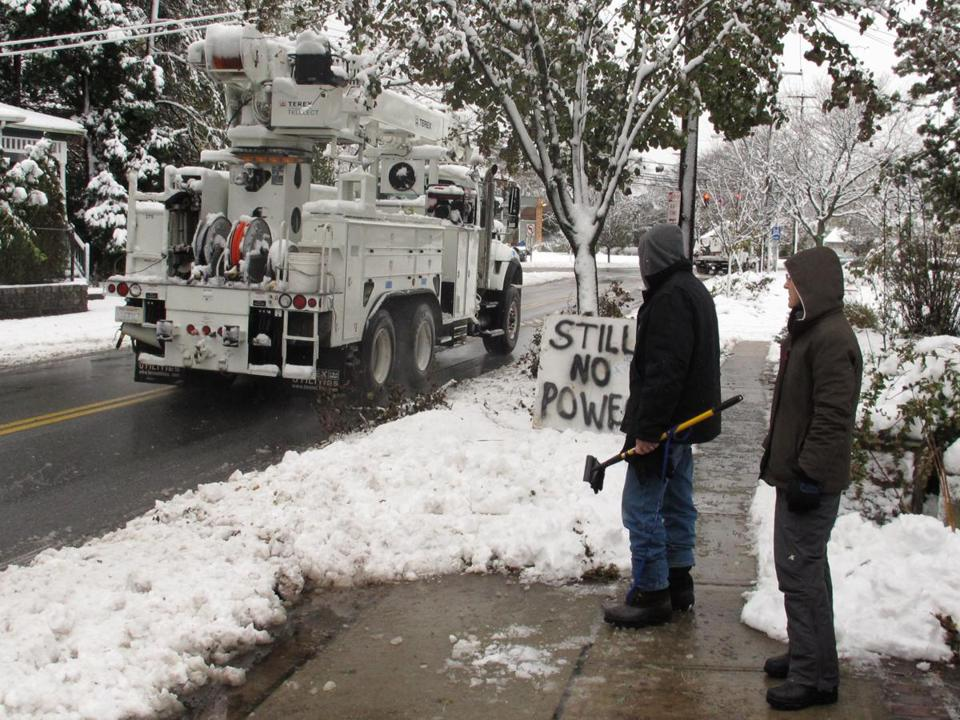 A couple saw a power truck pass their still darkened home in Farmingdale, N.Y. They have had no lights for 11 days.