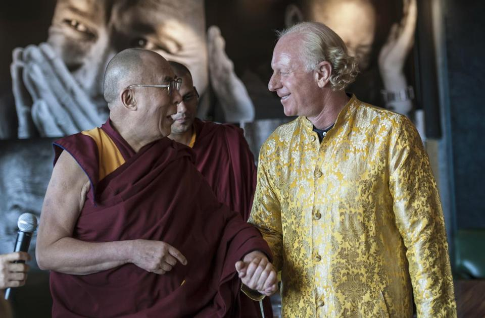 The Dalai Lama, spiritual leader of Tibetan Buddhists, speaks with Bobby Sager while visiting Sager's home in Boston last month.