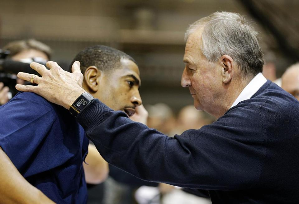 Former UConn coach Jim Calhoun hugs his successor, Kevin Ollie, after the Huskies' victory over Michigan State.