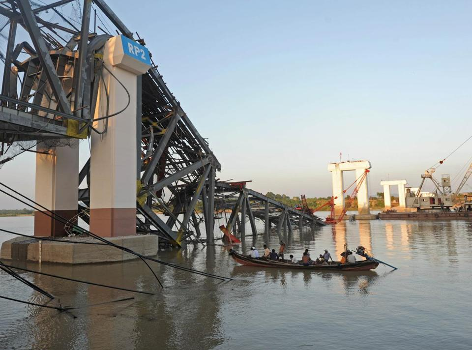 A rescue boat worked near a damaged bridge in Kyauk in central Myanmar, following a strong earthquake Sunday.