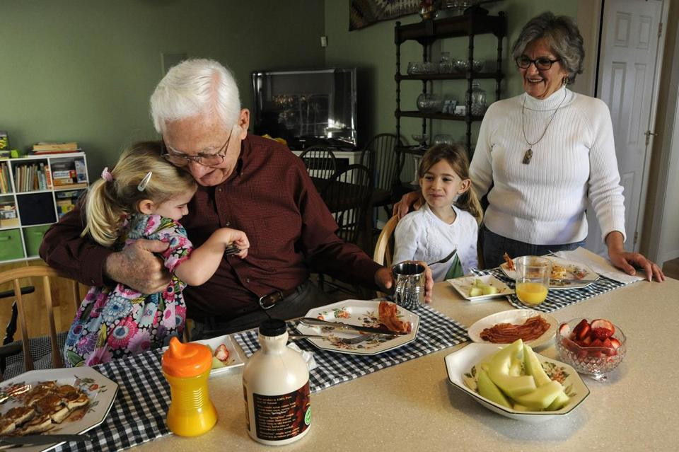 Roger and Joanna Beam host their grandchildren Charlotte (left), 3, and Grace Beam, 6, for an overnight visit in their Exeter, N.H., home, where they moved to be close to the children.