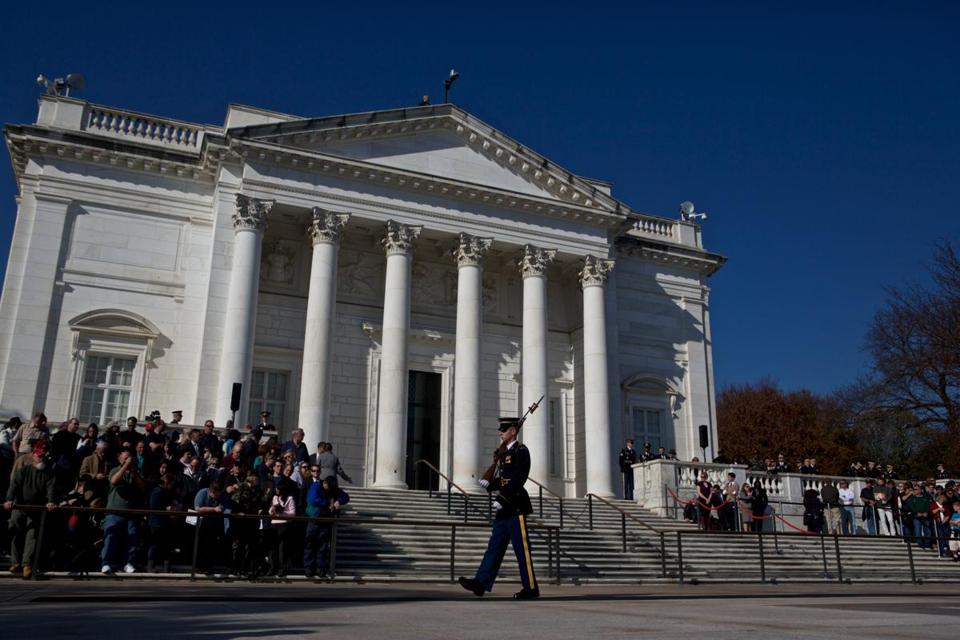 Spectators wait for the Presidential Wreath-Laying Ceremony to begin on Veteran's Day November 11, 2012 in Arlington, Va.