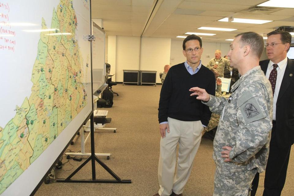 House Majority Leader Eric Cantor (left) visited the Virginia National Guard Joint Operations Center as Guard personnel prepared for possible recovery operations from Hurricane Sandy in Sandston, Virginia.