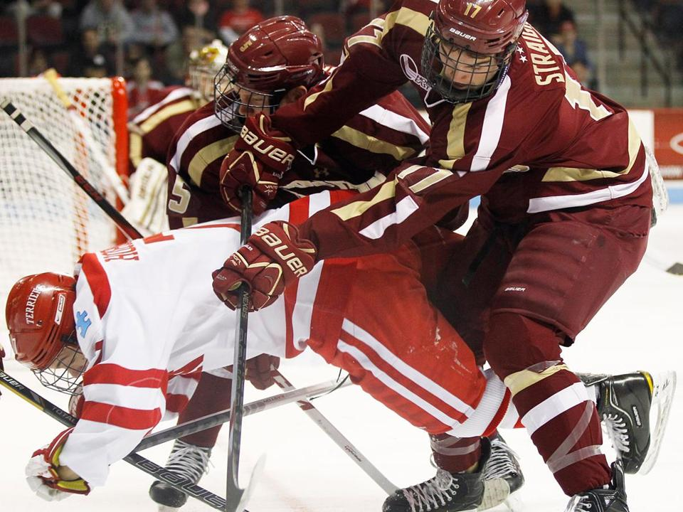 BC's Destry Straight plows into BU's Cason Hohmann, drawing a two-minute penalty during the first period.