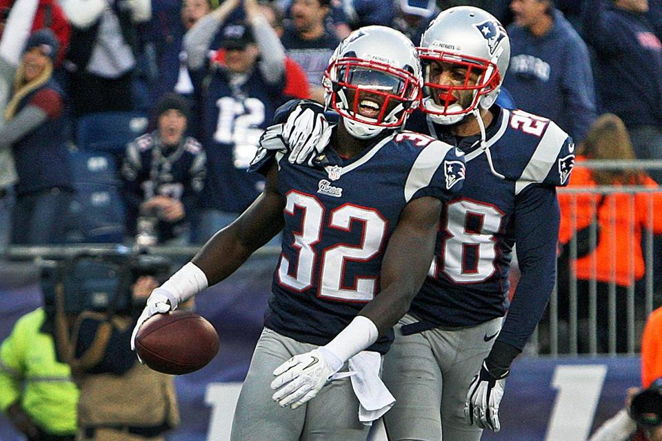 The Patriots' Devin McCourty (left) celebrated with teammate Steve Gregory after intercepting a pass in the end zone with 23 seconds to play to preserve a 37-31 victory.
