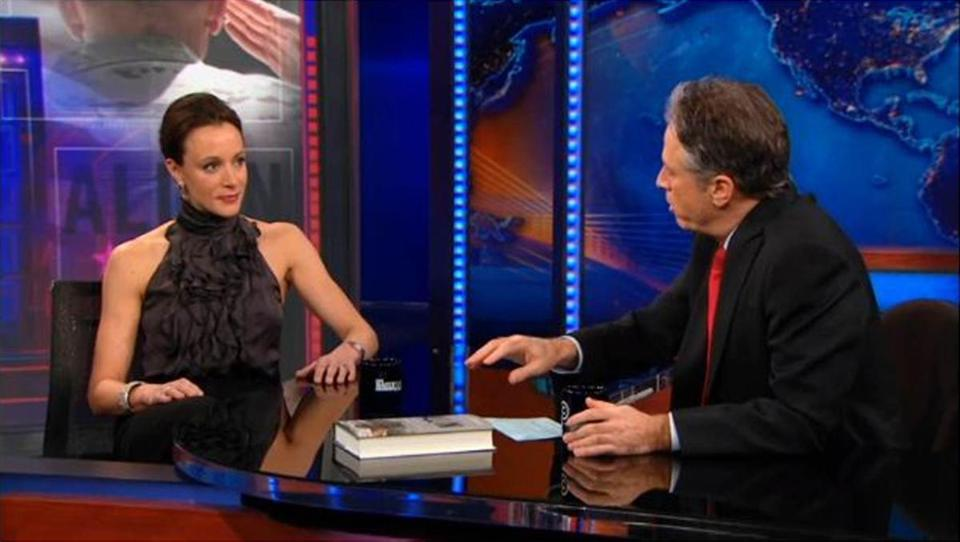 "Author Paula Broadwell baring her sculpted arms and shoulders on ""The Daily Show"" in January."