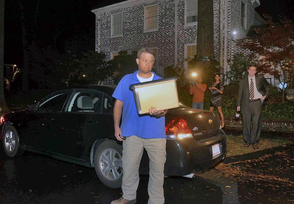 An unidentified man stood with a box in front of the home of Paula Broadwell in Charlotte, N.C. FBI agents appeared at Broadwell's home carrying the kinds of cardboard boxes often used for evidence gathering during a search.