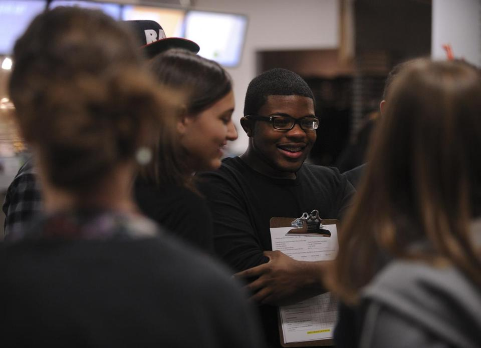 Romario Accime (center, at a Teen Night event at the ICA earlier this month) is going to Washington.