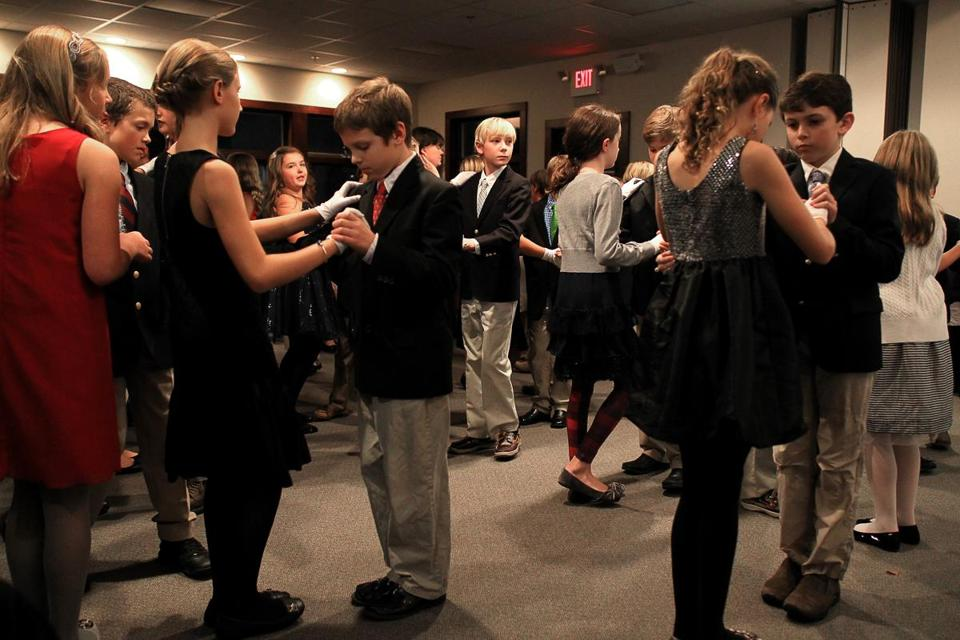 Among the fifth-graders in a social dance and etiquette course at Glastonbury Abbey in Hingham were Lydia Boer and Chris Williams (above). After pairing up dancers, the class ends with a disco line dance lesson.