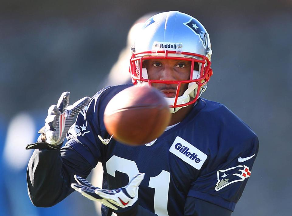 His suspension served, Aqib Talib suited up in a Patriots uniform for some hands-on work.