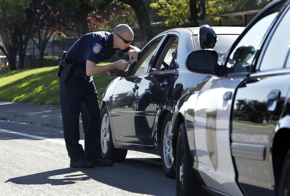 A police officer in Sacramento, where voters approved a sales tax hike to avoid cuts in things like public safety.