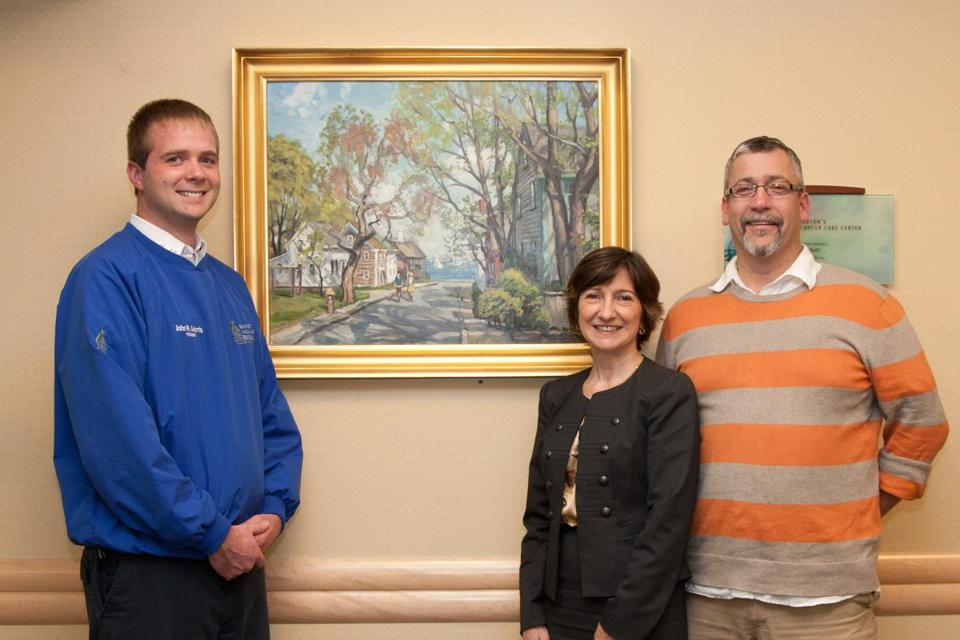 A painting by artist Ken Knowles (right) is being raffled as part of the LIghts of Love festival at Addison Gilbert Hospital in Gloucester. The raffle raises money for cancer care. With Knowles (right)are John Morris, owner of festival sponsor Beauport Ambulance Service, and Cindy Donaldson, vice president and executive director of Addison Gilbert.