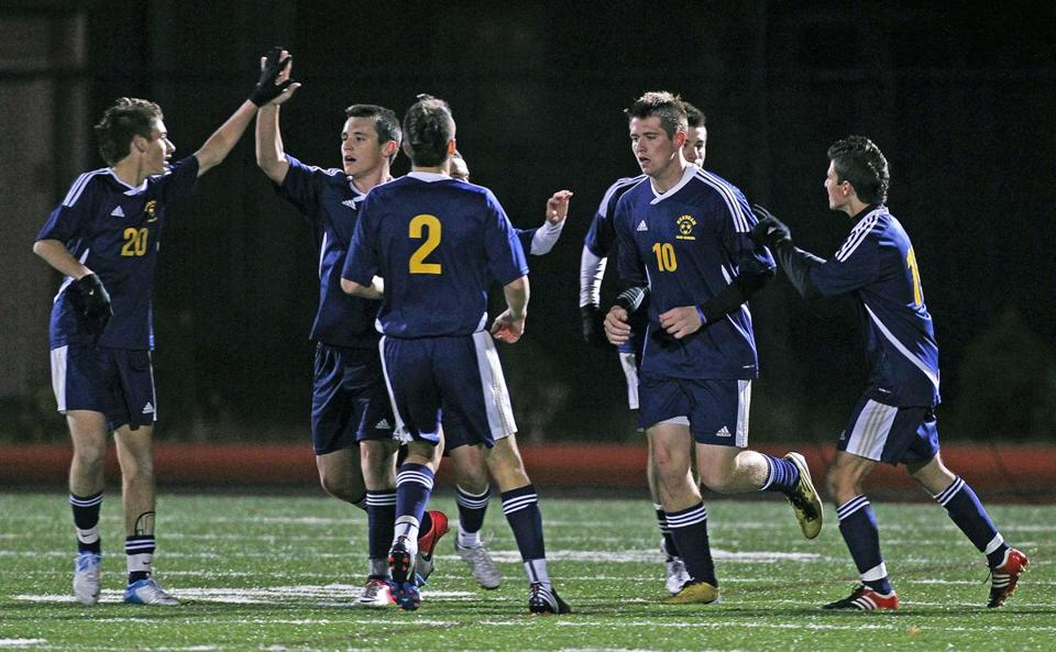 Needham players had something to celebrate after Mac Steeves (10) scored the first of his two goals in the first half in the win over Somerville.