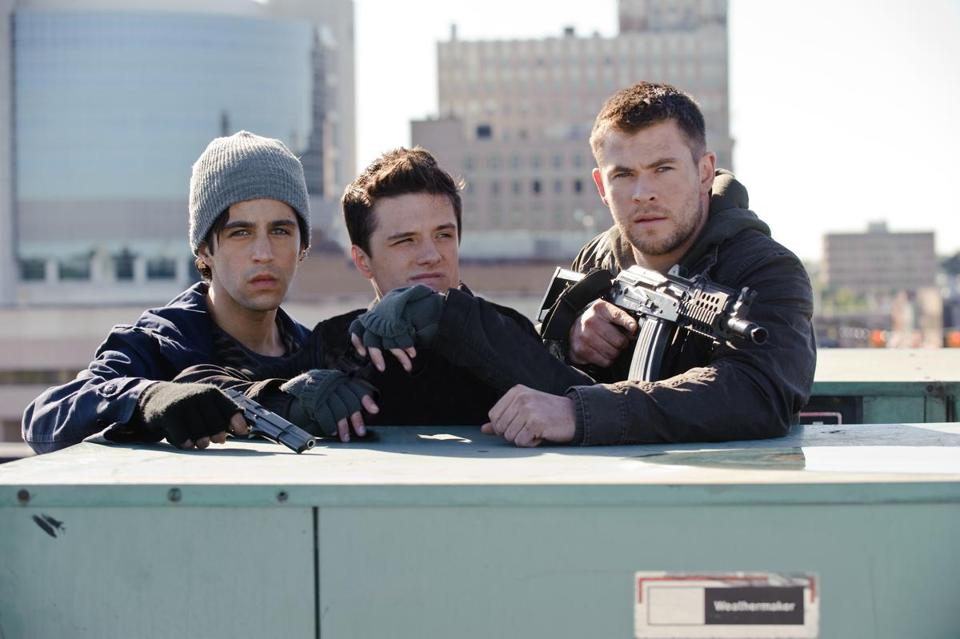 "From left: Josh Peck, Josh Hutcherson, and Chris Hemsworth in the remake of ""Red Dawn."""